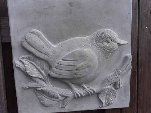 Wandtegel van beton met Vogeltje