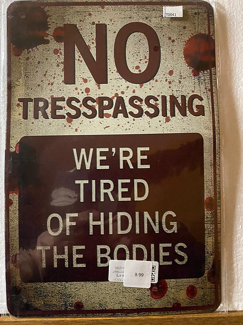 No tresspassing  we're tired of hiding bodies T0041