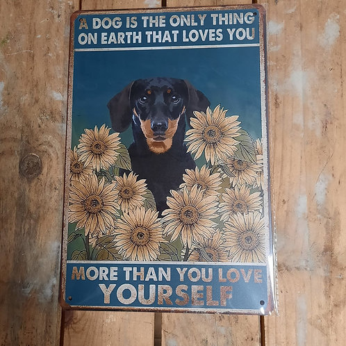 A dog is the only thing on earth that loves you KE014