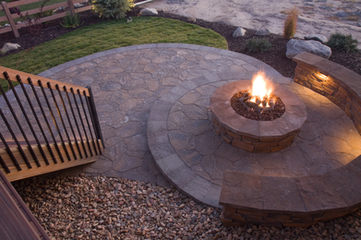 wood burning firepit with sitting retaining wall