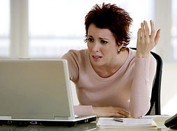 Woman Looking Confused with her computer