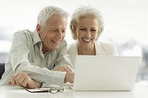 Elderly couple using a laptop