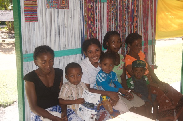 Stitch embroiderers with children