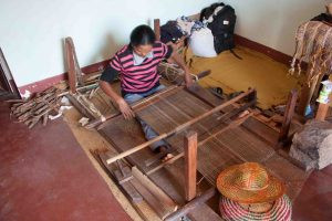 weaving a naturally dyed silk scarf