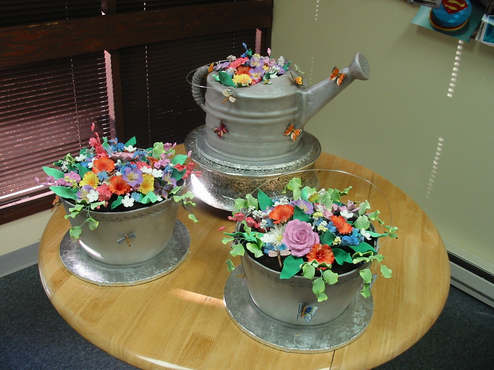Watering can wedding cakes