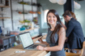 Business-woman-working-at-a-cafe-6222068
