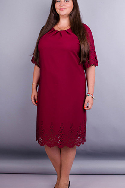 A nice tight dress with a punch at the bottom and on the sleeves to a large extent