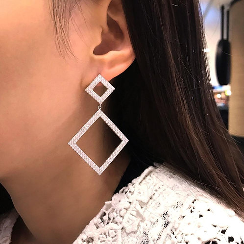 Square pure silver earrings combined with zirconia stones