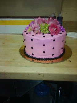 pink cake with black dots.jpg