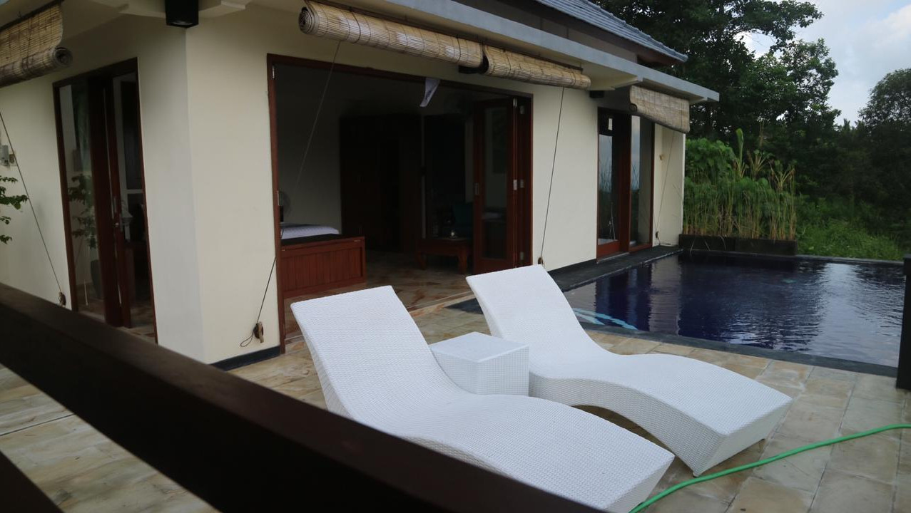 Sunbeds beside the pool.