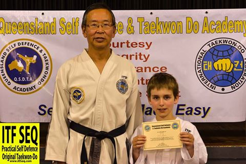 Photo of Aiden as an 8th gup student with Sabum Jackson