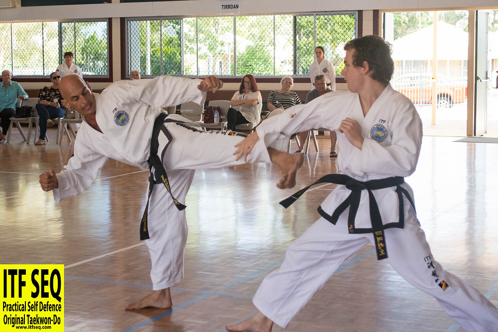 Black belts sparring