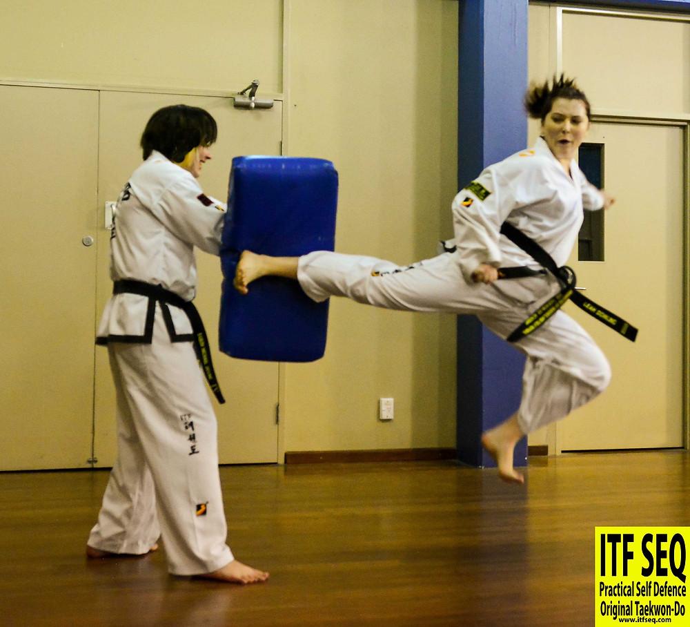 Jumping reverse turning kick