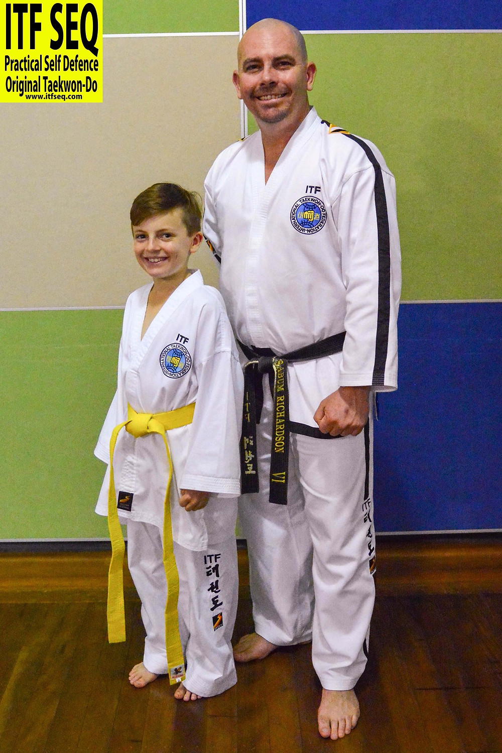 Patrick with Chief Instructor Kris afte rhe was promoted to 8th gup