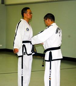 Senior Master Lai promoting Sabum Jackson to 5th Dan