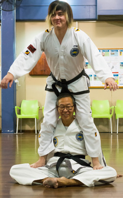Sabum Jackson stretching with help from Sabum Michael