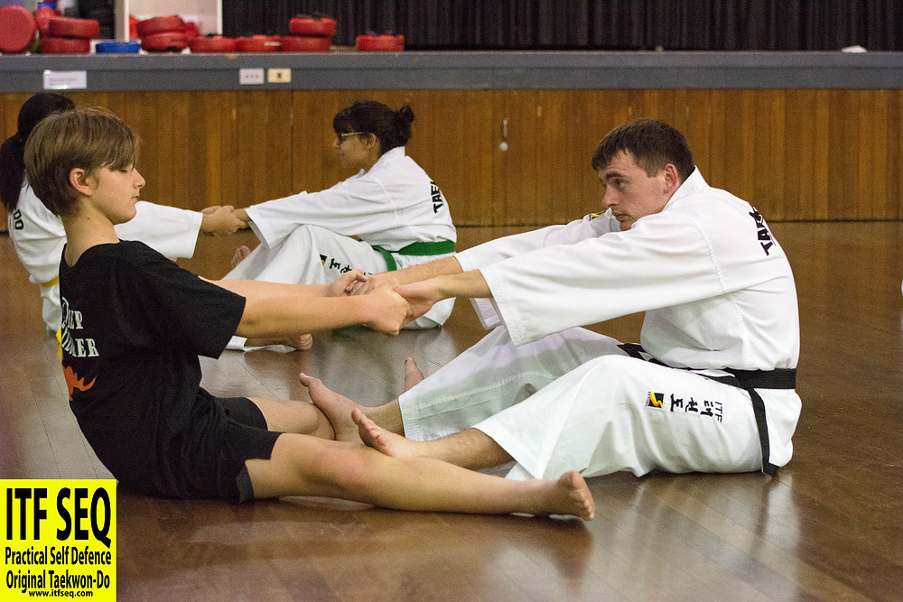 Taekwon-Do stretching exercise with partner