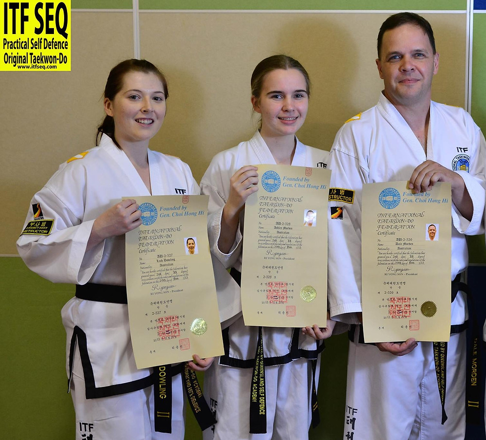 Photo of Assistant Isntructor Leah, Ashley and Instructor Dale with their 2nd Dan Certificates. standing alongside Chief Instrcutor Kirs Richardson from ITF Taekwon-Do Wide Bay