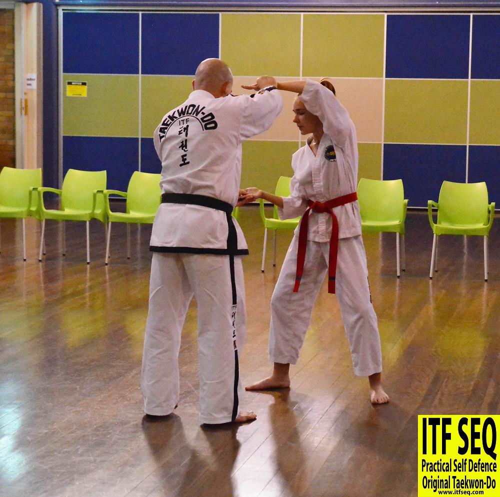Taekwon-Do instructor correcting student