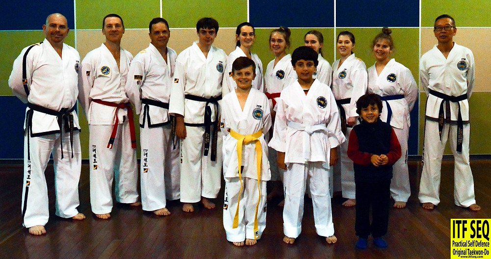 group photo of Taekwon-Do students who have recently graded to their next belt level