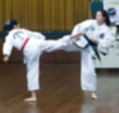 Chermside Taekwon-Do Assistant Instructor Leah Dowling sparring with Serna at the International Taekwon-Do Federation in Brisbane