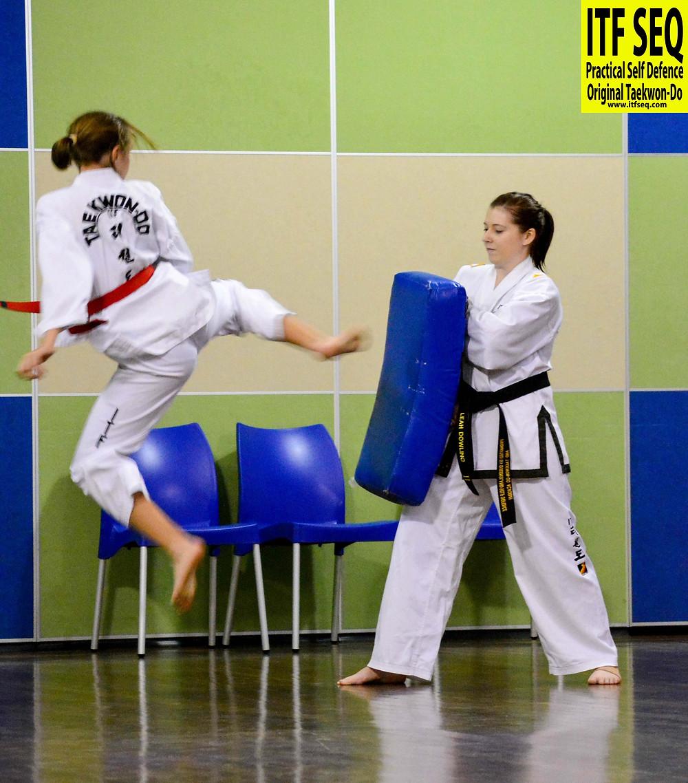 Training at ITF SEQ - Jumping Kicks