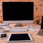 graphicstock-desk-with-various-gadgets-a