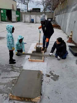Girls Working with concrete