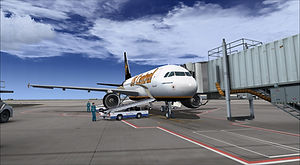 US Central A318 parked at a gate