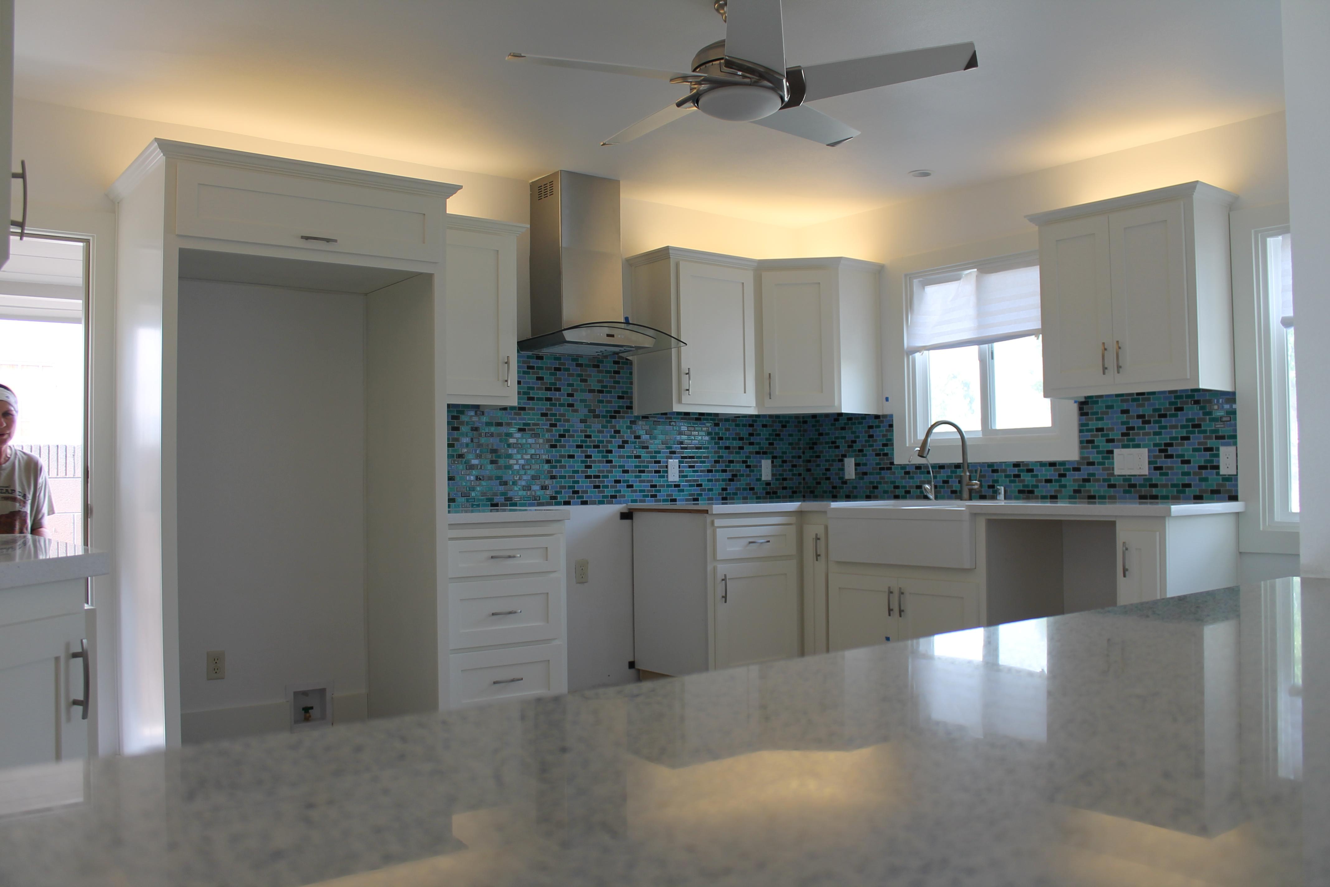 View through island into the kitchen