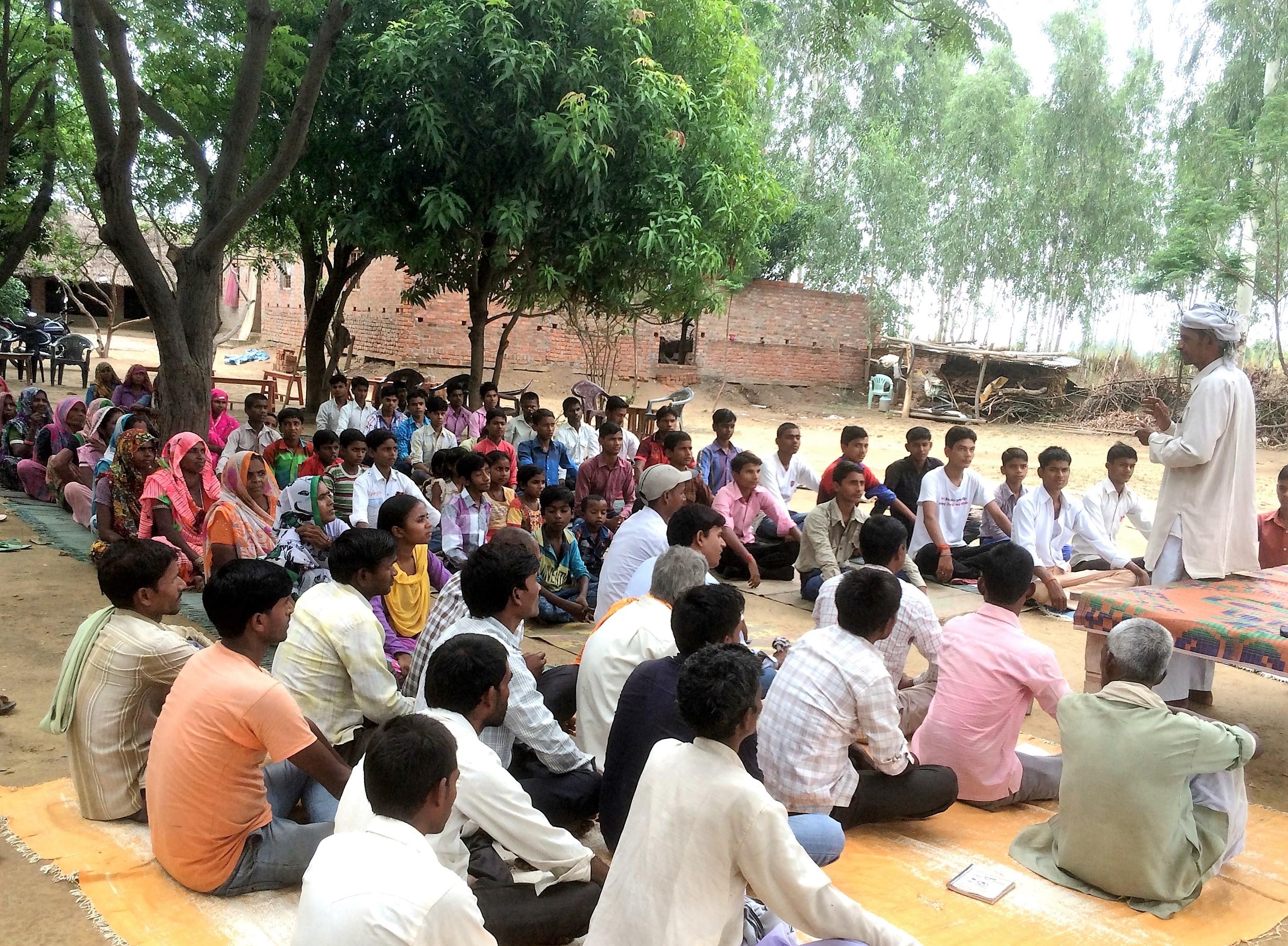 Shakir Ali, Manavodaya facilitator conducting  reflection exercise during Yoga camp village Bakhuri