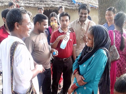 Participants interact with village women