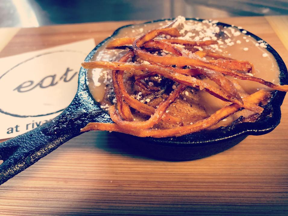 sweet potato blondie topped with sweet potato crisps and praline sauce