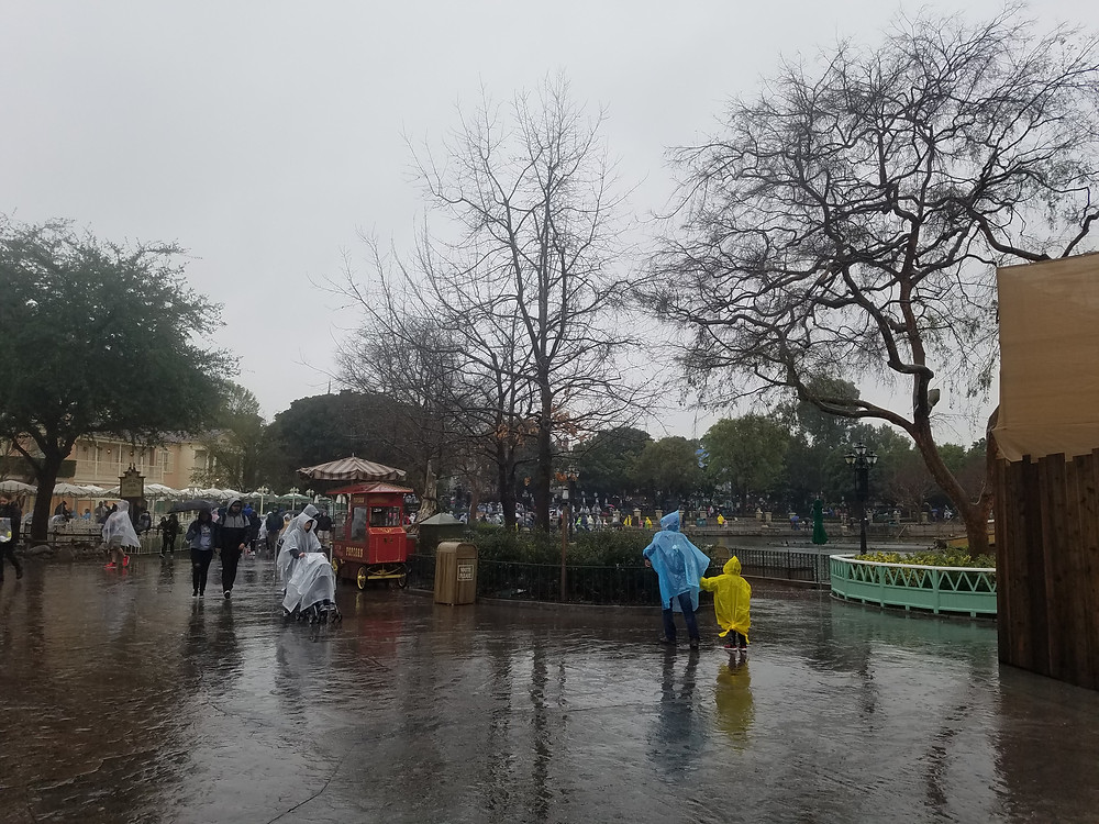 New Orleans Square in the rain ponchos and umbrellas