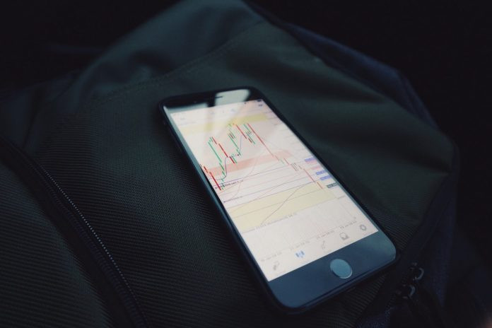 Investing in stocks Photo by Mark Finn on Unsplash