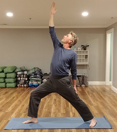 Male student Howard demoing Exalted Warrior pose