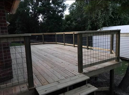 Deck  - light wood and wire fence with s