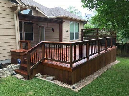 Deck - dark wood railing and stairs.jpg