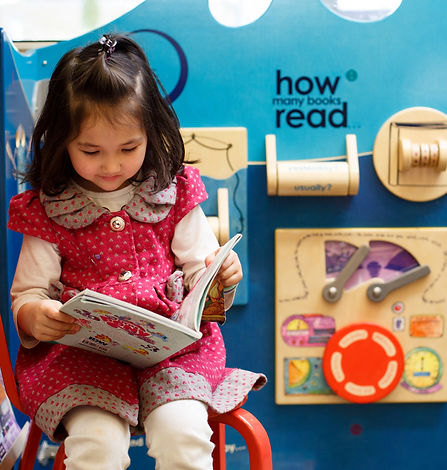 A young girl plays at one of Multnomah County Library's early literacy playspaces