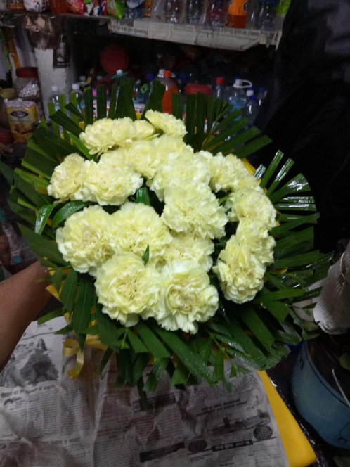 Yellow carnation bunch floristicudaipur online florist in bunch of 15 yellow carnations in beautiful paper packing mightylinksfo