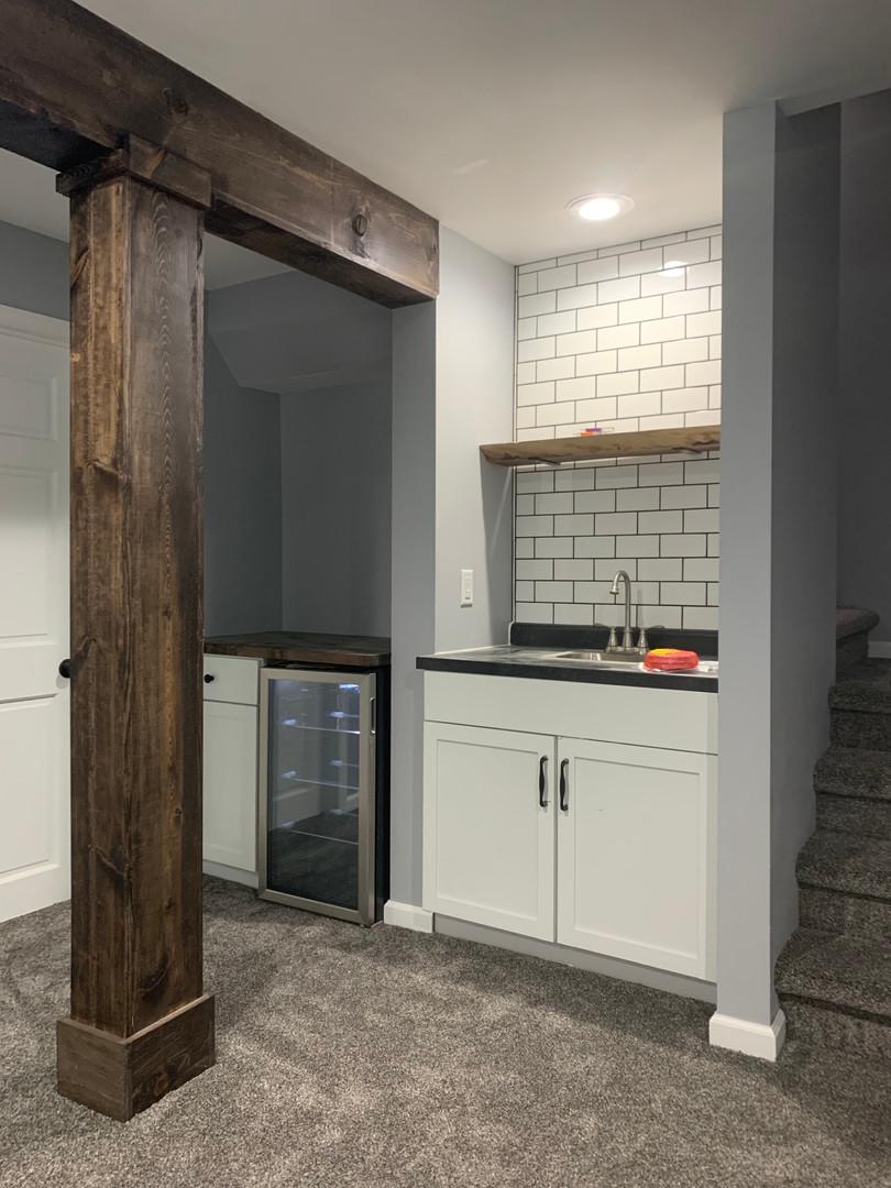Custom wood beam, Custom wet bar along with custom subway tile backsplash.