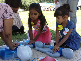 Teaching kids CPR at Touch-a-Truck