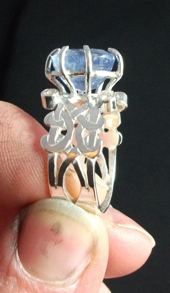 Wide celtic cylon & diamond ring, end view
