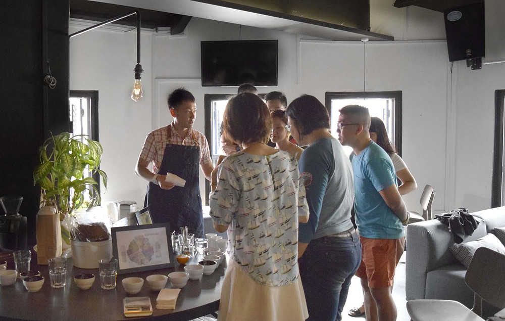 Dockyard Coffee founder and owner, Riyan Lee, conducts a cupping session for curious customers. Photo by Dockyard Coffee