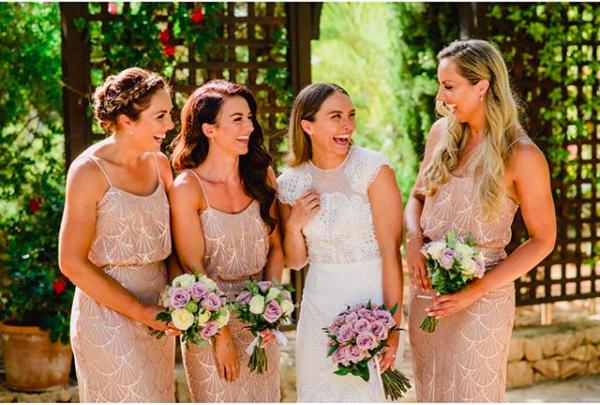 beautiful Bridal party of sisters laughing all with natural bridal hair at villa paissa den bernat i