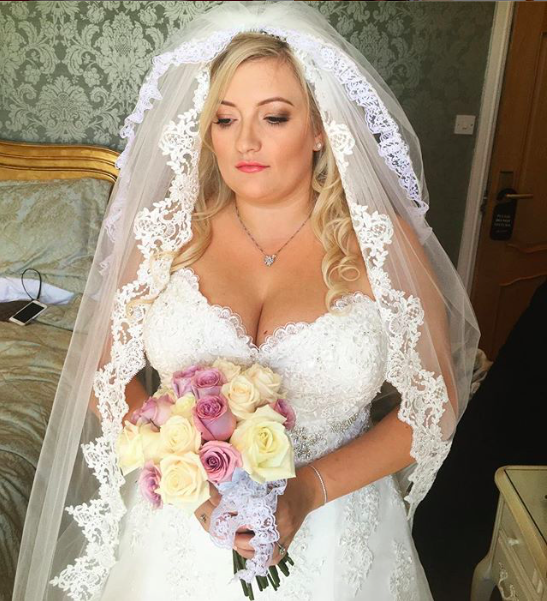 traditional bridal shot with traditional lace veil, beautiful curly wedding hair with volume and wed