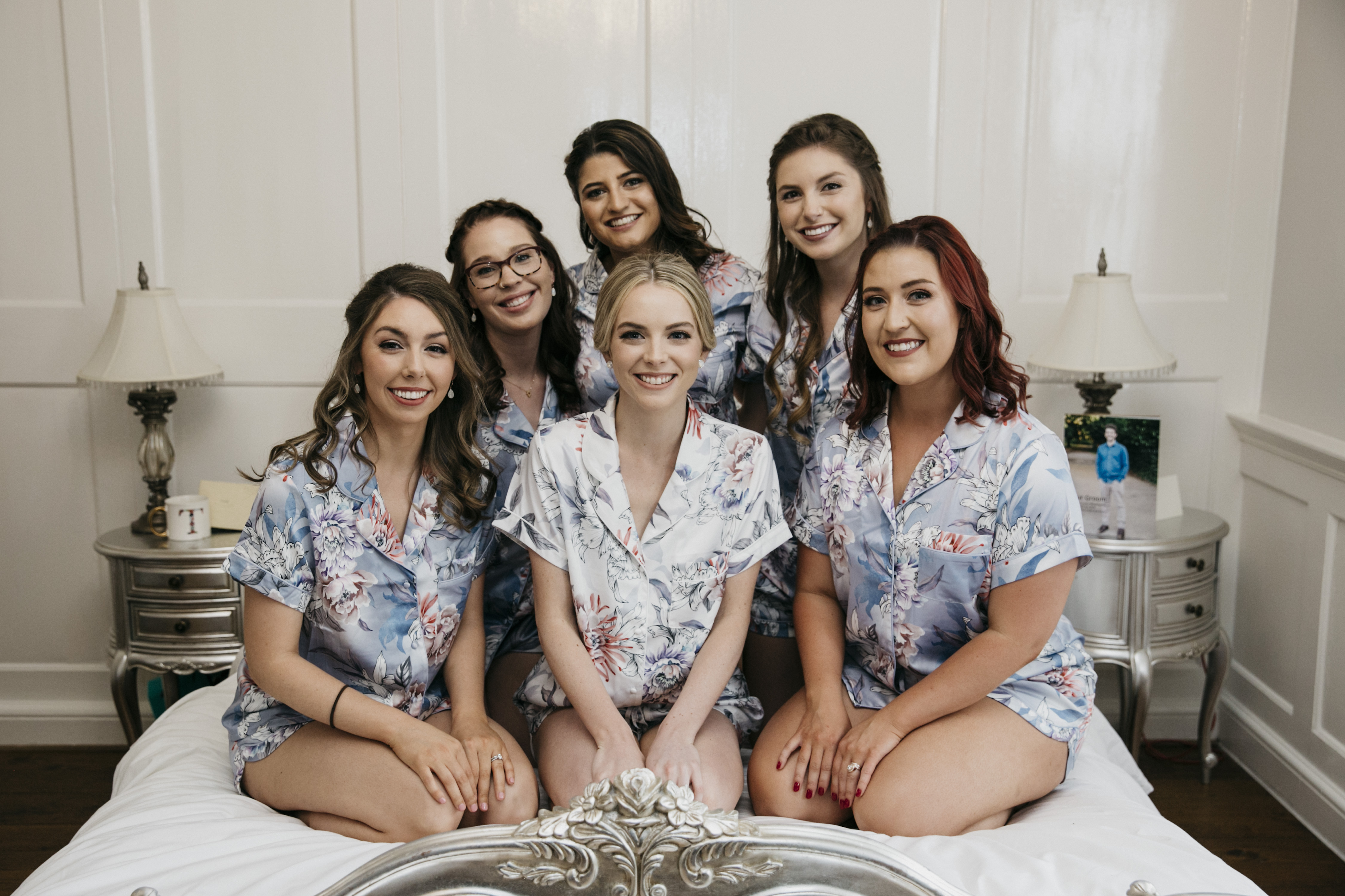 American bridal party, bridesmaids and mother of the bride accompany opera singer bride with beautif