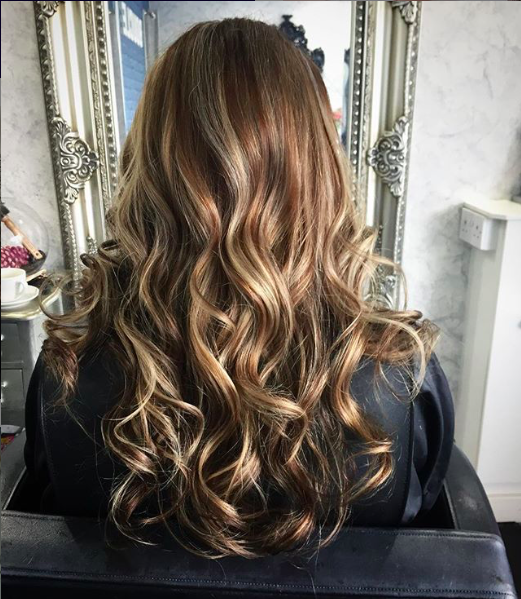 blended balayage with contrasting blonde and brunette tones to add dimensional colour by hair expert