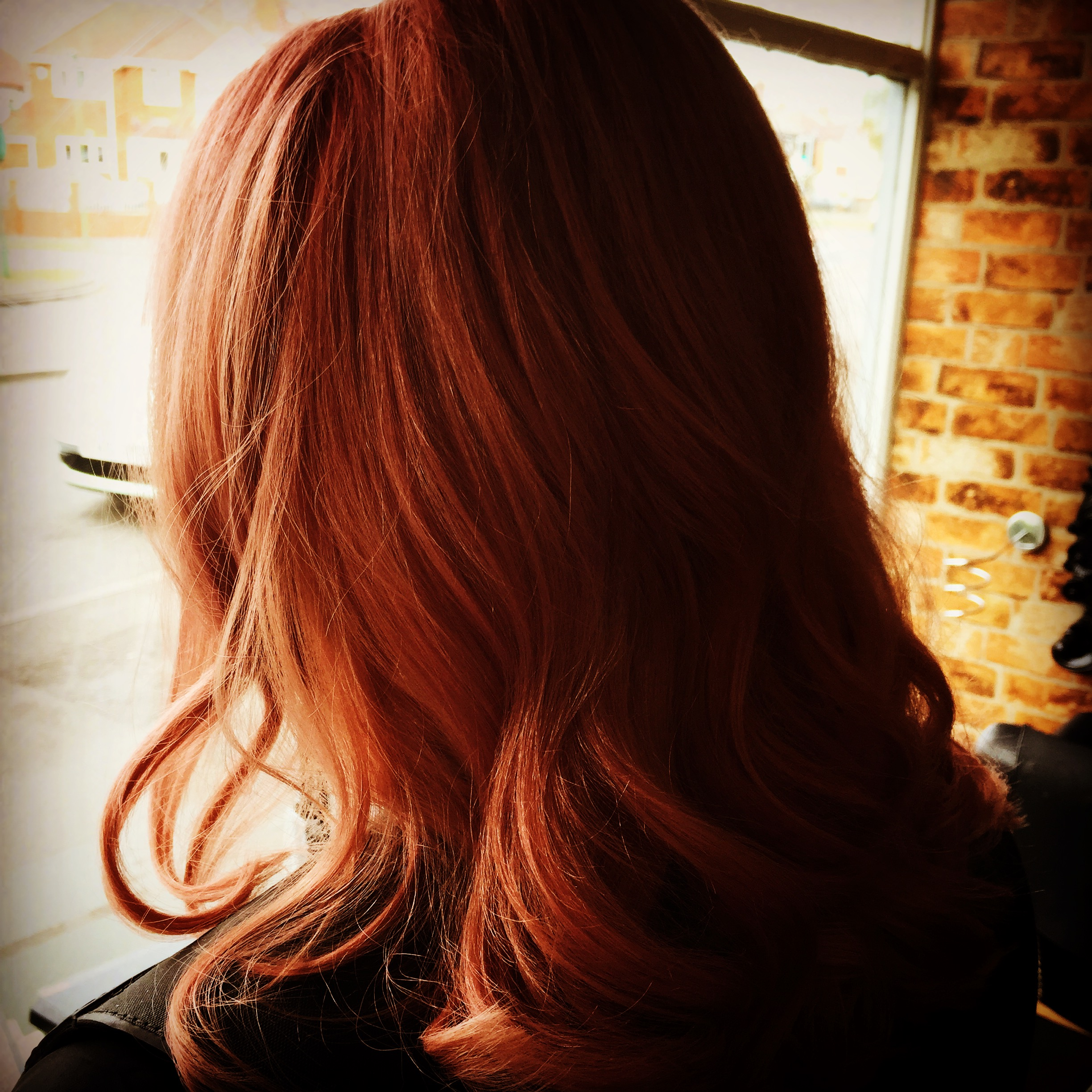 copper hair colour done by hair experts in professional hair salon
