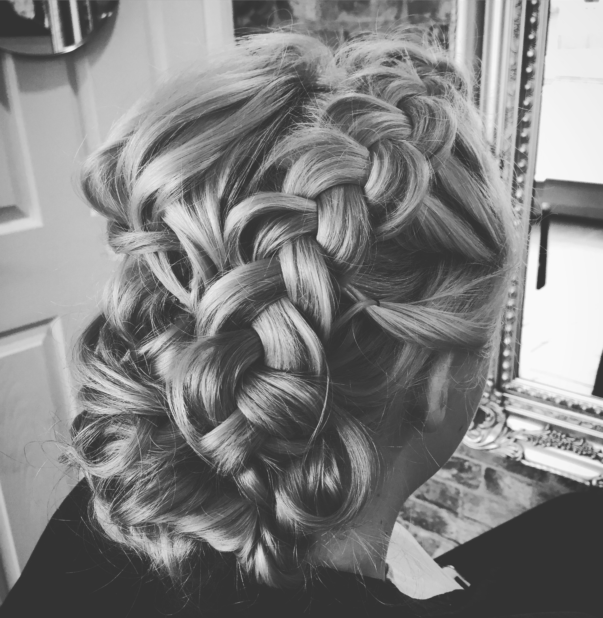 bridesmaid hair with loose plait and natural hair up pulled into low bun